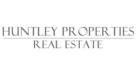 HUNTLEY PROPERTIES - REAL ESTATE logo