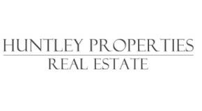 HUNTLEY PROPERTIES - REAL ESTATE logo